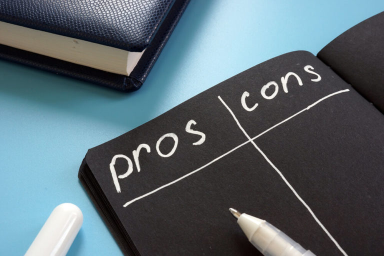 illustration of a pros and cons list on a black sheet of paper